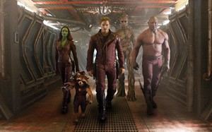 "FILE - This undated image released by Disney - Marvel shows, from left, Zoe Saldana, the character Rocket Racoon, voiced by Bradley Cooper, Chris Pratt, the character Groot, voiced by Vin Diesel and Dave Bautista in a scene from ""Guardians Of The Galaxy"". ""Guardians of the Galaxy"" became the summer's top-grossing movie at the North American box office with a $17.6 million weekend that narrowly bested the young adult melodrama ""If I Stay.""(AP Photo/Disney - Marvel, File)"