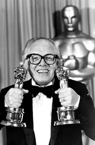 "FILE - In this Monday, April 11, 1983 file photo, British actor and director Richard Attenborough holds his two Oscars for his epic movie ""Gandhi"" at the 55th annual Academy Awards in Los Angeles, Ca.,. Acclaimed actor and Oscar-winning director Richard Attenborough, whose film career on both sides of the camera spanned 60 years, died on Sunday, Aug. 24, 2014. He was 90. (AP Photo, File)"