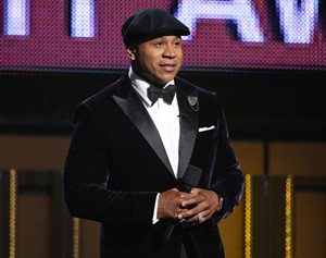 "FILE - In this Sunday, Jan. 26, 2014, file photo, host LL Cool J speaks on stage at the 56th annual Grammy Awards at Staples Center, in Los Angeles. LL Cool J says it's important to help out kids in need. The ""NCIS Los Angeles"" actor and hip-hop star handed out backpacks with school supplies to children in the Jamaica, Queens area of New York, on Sunday, Aug. 24, 2014. (Photo by Matt Sayles/Invision/AP, File)"
