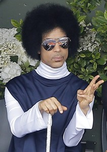 "FILE - In this Monday, June 2, 2014, file photo, U.S. pop singer Prince watches the fourth round match of the French Open tennis tournament between Spain's Rafael Nadal and Serbia's Dusan Lajovic at the Roland Garros stadium, in Paris. Prince announced on Monday, Aug. 25, 2014, that he would release a new album entitled, ""Art Official Age"" on Warner Bros. Records, the label Prince was signed to from 1978 to the mid-1990s, but later battled for the rights of his music. (AP Photo/Michel Spingler, File)"