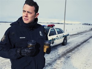 """This photo released by FX Networks shows Colin Hanks as Gus Grimley in """"Fargo,"""" season one. The TV series has 18 nominations and one win for the 2014 Emmy Awards. The 66th Primetime Emmy Awards are on Monday, August 25, 2014. (AP Photo/Matthias Clamer/FX)"""