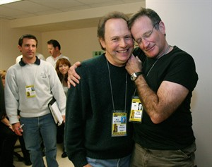 """FILE - In this Feb. 28, 2004 file photo, Oscar host Billy Crystal, center, and presenter Robin Williams, right, joke around after a writers' meeting for the 76th annual Academy Awards in Los Angeles. Crystal will honor Williams as part of the traditional """"In Memoriam"""" segment at the Emmy Awards for industry members who died during the past year. Williams was found dead by suicide in his Northern California home Aug. 11. (AP Photo/Kevork Djansezian, File)"""
