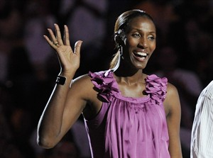 """FILE - This Aug. 10, 2010, file photo shows retired Los Angeles Sparks basketball player Lisa Leslie waving to the crowd during a ceremony to retire her jersey at halftime of a WNBA basketball game between the Indiana Fever and the Sparks in Los Angeles. CBS Sports Network will air an all-women sports show starting next month. CBS said Tuesday, Aug. 26, 2014, the weekly hour-long, prime-time program on the cable channel will be the first of its kind. """"We Need to Talk"""" premieres Sept. 30. The panel will feature a core of CBS Sports announcers: Lesley Visser, Amy Trask, Tracy Wolfson, Dana Jacobson and Allie LaForce. Other contributors include Andrea Kremer, Laila Ali, Lisa Leslie, Dara Torres, Swin Cash and Summer Sanders. (AP Photo/Chris Pizzello, File)"""
