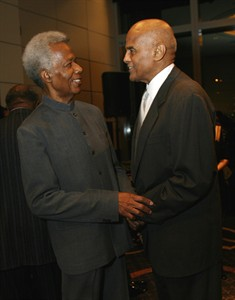 """FILE - In this Oct. 6, 2006, file photo, filmmaker William Greaves, left, and talks with actor Harry Belafonte at the 80th anniversary celebration of Harlem's Schomburg Center at Jazz at Lincoln Center in New York. Greaves, the Emmy-award winning producer and co-host of the groundbreaking television show """"Black Journal"""" and a prolific filmmaker whose subjects ranged from Muhammad Ali to the Harlem Renaissance to the black middle class, has died. He was 87. (AP Photo/Rick Maiman, File)"""