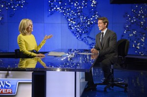 "In this Wed., Aug. 27, 2014 photo provided by ABC, Diane Sawyer, left, signs off on her last broadcast as anchor of ""World News,"" in New York. Sawyer told viewers that it has been wonderful to be the ""home port"" of the network's news team each weeknight. David Muir, right, will become anchor and managing editor of the program in September. (AP Photo/ABC, Ida Mae Astute)"