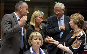 FILE - In this Friday, Aug. 15, 2014 file photo, European Union foreign policy chief Catherine Ashton, right, speaks with Italian Foreign Minister Federica Mogherini, second left, and Swedish Foreign Minister Carl Bildt, second right during a meeting in Brussels. Within the EU's ranks, Baroness Catherine Ashton now is the most recognizable woman among the EU officials, the foreign policy chief who flies across the world, hobnobs with the great and powerful to deal with anything from the Iran nuclear issue to the fighting in Ukraine and the Middle East. (AP Photo/Virginia Mayo, File)