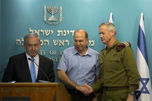Israeli Prime Minister Benjamin Netanyahu, left, stands with Israel's Defense Minister Moshe Yaalon, center, and Israeli Chief of Staff Lt. Gen. Benny Gantz, during a press conference at the prime minister's office in Jerusalem, Wednesday, Aug. 27, 2014. Israel's prime minister declared victory Wednesday in the recent war against Hamas in the Gaza Strip, saying the military campaign had dealt a heavy blow and a cease-fire deal gave no concessions to the Islamic militant group.(AP Photo/Sebastian Scheiner)