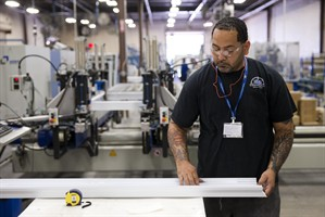 In this Aug. 7, 2014 photo a worker assembles construction supplies at Northeast Building Products in Philadelphia. The Commerce Department issues its second estimate of how fast the U.S. economy grew in the April-June quarter on Thursday, Aug. 28, 2014. (AP Photo/Matt Rourke)