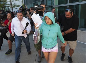 Lilia Ratmanski, 25, is released on bail at the Brampton courthouse on Thursday August 28, 2014. A booze-fuelled fight between two women who were allegedly drinking and smoking in an airplane bathroom prompted Sunwing to turn a Cuba-bound flight back to Toronto, the airline said. THE CANADIAN PRESS/Aaron Vincent Elkaim