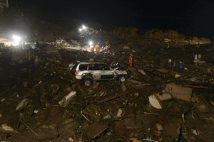 Rescue workers search for victims in the aftermath of a landslide that hit Yingping village in Fuquan city in southwest China's Guizhou province Thursday Aug. 28, 2014. Six people died and 21 remained missing Thursday after a landslide hit a village in southwestern China, according to Chinese state media. (AP Photo) CHINA OUT