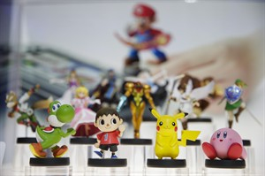 """In this June 10, 2014 file photo, amiibo characters for Wii U are on display at the Nintendo booth during the Electronic Entertainment Expo, in Los Angeles. Pikachu and Link will be among the first characters coming to """"amiibo."""" Nintendo announced the 12 characters on Friday, Aug. 29, 2014, that will be part of its upcoming toys-meet-game franchise set for release later this year. (AP Photo/Jae C. Hong, File)"""