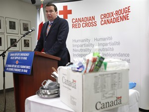 Minister of International Development Christian Paradis speaks at a press conference to announce the deployment of relief supplies from Canada's emergency stockpile to conflict affected people in northern Iraq at the Canadian Red Cross national office in Ottawa on Friday, August 29, 2014. THE CANADIAN PRESS/Patrick Doyle