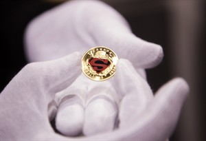 One of four new collector coins from the Royal Canadian Mint featuring Superman are displayed during an unveiling ceremony at Fan Expo in Toronto on Friday, August 29, 2014. THE CANADIAN PRESS/ Jesse Johnston