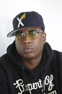 "FILE - In this April 29, 2013 file photo, American rapper Talib Kweli, who performs under the name Talib Kweli, poses for a portrait during an interview in Los Angeles. Rappers are making their voices heard in song and on the ground in Ferguson, Missouri, in the wake of Mike Brown's death, channeling hip-hop's earlier roots when the genre worked as a voice for the oppressed and spoke out against injustice. Kweli, and J. Cole, marched in Ferguson and spoke out about injustice; David Banner appeared on CNN; and Lauryn Hill dedicated her song ""Black Rage"" - which uses some of Rodgers and Hammerstein's ""My Favorite Things"" - to the Ferguson community. (AP Photo/Nick Ut, file)"