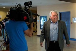 Mediator Vince Ready arrives to meet with B.C. Teachers' Federation president Jim Iker and B.C. Public School Employers' Association negotiator Peter Cameron in Richmond, B.C., on Thursday August 28, 2014. Ready has walked away from talks between British Columbia teachers and their employer, smothering hopes of parents that the school year would start on time. THE CANADIAN PRESS/Darryl Dyck
