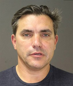"""CORRECTS AGE TO 54 This photo provided by the Southampton Town Police Department on Long Island shows celebrity chef Todd English, 54, after his arrest early Sunday morning, Aug 31, 2014 in Southampton, N.Y., where he was charged with driving while intoxicated. English has opened a number of restaurants around the country, including Olives, Figs, and Fish Club. He's also been a regular on television programs including """"Iron Chef USA."""" Authorities say he posted $1,500 bail at Southampton Town Justice Court. (AP Photo/Southampton Town Police Department)"""