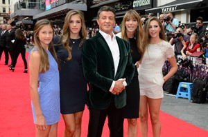 U.S actor Sylvester Stallone, center, with his wife Jennifer Flavin, second right, and daughters, Sophia Stallone, Sistene Stallone and Scarlet Stallone arrive for the World Premiere of The Expendables 3 at a central London cinema, Monday, Aug. 4, 2014. THE CANADIAN PRESS/AP, Jonathan Short/Invision