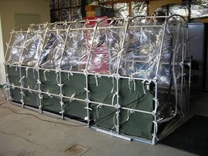"""In this undated photo released by the Center for Disease Control, a Aeromedical Biological Containment System which looks like a sealed isolation tent for Ebola air transportation is shown. On Thursday afternoon July 31, 2014, officials at Atlanta's Emory University Hospital said they expected one of the Americans to be transferred there """"within the next several days."""" The hospital declined to identify which aid worker, citing privacy laws. (AP Photo/Center for Disease Control)"""
