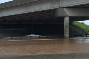 A vehicle is stuck in flood waters on the QEW approaching Guelph Line, Aug. 4, 2014. TWITTER/@Amybomburry