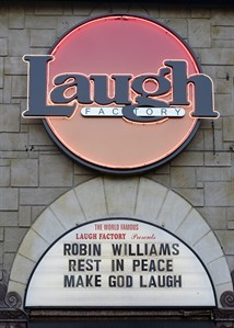 The marquee of the Laugh Factory shows a message in memory of actor/comedian Robin Williams in the Hollywood district of Los Angeles Monday, Aug. 11, 2014. Williams, the Academy Award winner and comic supernova whose explosions of pop culture riffs and impressions dazzled audiences for decades and made him a laureate for the Information Age, died Monday in an apparent suicide at his San Francisco Bay area home. He was 63. (AP Photo/Kevork Djansezian)