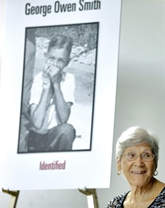 Ovell Krell, sister of George Owen Smith, the first victim positively identified from one of the 55 unmarked graves the former Arthur G. Dozier School for Boys in Marianna, Fla., smiles as she listens during a news conference Thursday, Aug. 7, 2014, at the University of South Florida in Tampa, Fla. University researchers will exhume Smith's remains and return them to his family. Smith was 14 when he was sent to the school in 1940, and was never seen alive by his family again. (AP Photo/Chris O'Meara)