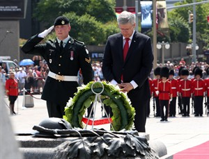 Prime Minister Stephen Harper pauses for a moment after he laid a wreath at the National War Memorial during a ceremony to mark the 100th Anniversary of the First World War, in Ottawa, Monday August 4, 2014. THE CANADIAN PRESS/Fred Chartrand
