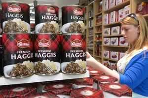 A woman browses haggis products at a souvenir shop in central Edinburgh, Scotland, Monday July 28, 2014. The Scottish national dish is a blend of offal, oats and spices - traditionally served up in a sheep's stomach. (AP Photo/ Jill Lawless)