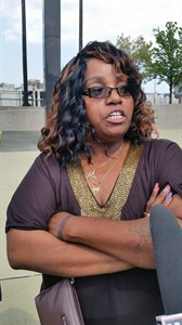 """Bernita Spinks, aunt of slaying victim Renisha McBride, speaks to reporters outside the Wayne County Circuit Court building in Detroit, on Thursday, Aug. 7, 2014, after a jury found Theodore Wafer guilty of second-degree murder in the shotgun death of McBride, 19. Wafer shot McBride on Nov. 2, 2013, his porch in the Detroit suburb of Dearborn Heights after she banged on his door in the middle of the night. Spings said the killing showed the danger of the thoughtless use of firearms and didn't reflect any racial motive by the white homeowner. Spinks said people need to use """"the right judgment"""" if they are going to have guns in their homes. (AP Photo/David N. Goodman)"""