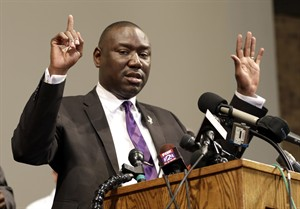 Brown family attorney Benjamin Crump speaks during a news conference to share preliminary results of a second autopsy done on 18-year-old Michael Brown, Monday, Aug. 18, 2014, in St. Louis County, Mo. The independent autopsy shows Brown was shot at least six times. (AP Photo/Jeff Roberson)