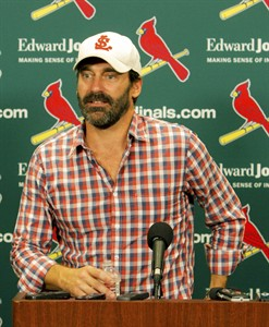 Actor and St. Louis native Jon Hamm addresses the media prior to a baseball game between the St. Louis Cardinals and the Cincinnati Reds, Monday, Aug. 18, 2014, in St. Louis. Hamm is being honored tonight by the Cardinals with a give-away promotion, and portions of proceeds from the purchase of promotional tickets being donated to St. Jude Children's Medical Research Hospital in his honor. (AP Photo/Scott Kane)