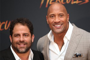 "Director Brett Ratner, left, and Dwayne Johnson poses for photos as he arrives for an event to promote his film ""Hercules,"" in Mexico City, Monday, Aug. 18, 2014. (AP Photo/Marco Ugarte)"