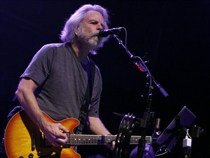 "FILE - This March 16, 2014 file photo shows Grateful Dead alumni Bob Weir and his band, Ratdog, performing in Atlanta. Weir is canceling all of the tour dates he had planned through January 2015. The Grateful Dead founder posted a message Sunday, Aug. 10, on RatDog's website that says ""circumstances have necessitated that all scheduled tour dates for Bob Weir & RatDog are being canceled."" (Photo by Dan Harr/Invision/AP, File)"