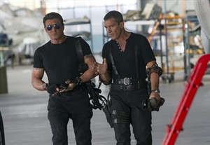 """This image released by Lionsgate shows Sylvester Stallone, left, and Antonio Banderas in a scene from """"Expendables 3."""" (AP Photo/Lionsgate, Phil Bray)"""