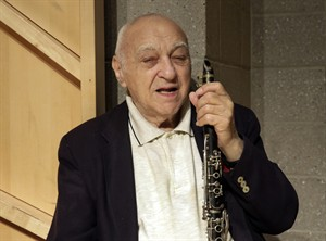 Clarinetist Sol Yaged, 91, poses for a photo during a rehearsal at the Baruch Performing Arts Center, in New York, Friday, Aug. 8, 2014. (AP Photo/Richard Drew)