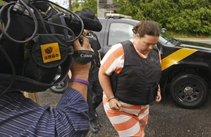 St. Lawrence County Sheriff's deputies escort Nicole Vaisey, 25, into Fowler Town Court for her preliminary hearing, Thursday, Aug 21, 2014, in Fowler, N.Y. Vaisey and Stephen Howells II are charged with abducting and sexually abusing two young Amish sisters as the girls worked their family's roadside vegetable stand in Oswegatchie, N.Y. on Wednesday, Aug. 13, 2014. (AP Photo/Watertown Daily Times, Jason Hunter) MANDATORY CREDIT, SYRACUSE OUT