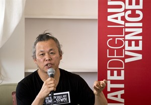 "South Korean director Kim Ki-duk speaks during a press conference for his film One on One at the 71st edition of the Venice Film Festival in Venice, Italy, Wednesday, Aug. 27, 2014. Kim's t-shirt reads, ""The truth shall not sink with Sewol"", a reference to the April 2014 South Korean ferry disaster that left more than 300 people dead or missing. (AP Photo/David Azia)"