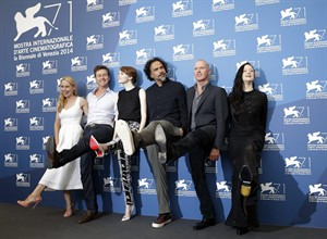 From left, actors Amy Ryan, Edward Norton, Emma Stone, director Alejandro Gonzalez Inarritu, actors Michael Keaton and Andrea Riseborough pose for photographers during a photo call for Birdman at 71st edition of the Venice Film Festival in Venice, Italy, Wednesday, Aug. 27, 2014. (AP Photo/David Azia)