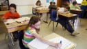 Students work on homework during class at Milesville School on Wednesday, May 2, 2012, in Haakon County, S.D. An elementary school in Quebec's Saguenay region has decided to ban homework in all classes from Grade 1 to Grade 6. THE CANADIAN PRESS/AP/Kristina Barker/Journal staff)