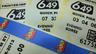 File photo of Lotto 6-49 tickets. THE CANADIAN PRESS/Richard Plume