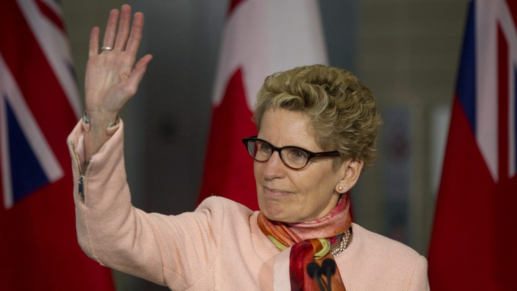 Ontario Premier Kathleen Wynne stands at the podium as the provincial government announces the launch of its new birth certificates in Toronto on Tuesday, March 10, 2015. THE CANADIAN PRESS/Chris Young