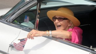 """In this June 30, 2012 file photo, parade grand marshall actress Ellen Albertini Dow waves to the crowd as she rides in the back of a classic car during the Six-County Firemen's Parade in Mount Carmel, Northumberland County. Dow, a feisty and fiercely independent character actor best known for her salty rendition of """"Rapper's Delight"""" in """"The Wedding Singer,"""" died Monday, May 4, 2015, according to her agent Juliet Green. She was 101. (Mike Staugaitis/The News-Item via AP, File)"""