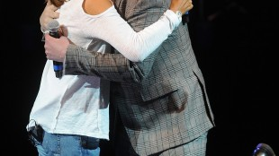 Musician Billy Corgan, right, and Hoda Kotb embrace at the National Concert Day at Irving Plaza on Tuesday, May 5, 2015, in New York. (Photo by Brad Barket/Invision/AP)