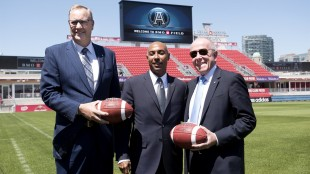 George Cope, (left to right) CEO of Bell Canada, Jeffrey Orridge, CFL commissioner, and Larry Tanenbaum, MLSE chairman, pose at BMO Field following a press conference in Toronto on Wednesday, May 20, 2015. Bell and MLSE have purchased the Toronto Argonauts plan to relocate the team to BMO Field. THE CANADIAN PRESS/Darren Calabrese