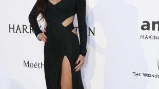 Model Adriana Lima poses for photographers upon arrival for the amfAR Cinema Against AIDS benefit at the Hotel du Cap-Eden-Roc, during the 68th Cannes international film festival, Cap d'Antibes, southern France, Thursday, May 21, 2015. (AP Photo/Thibault Camus)