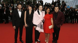 From left, the Un Certain Regard jury, actor Tahar Rahim, actress Nadine Labaki, actress Isabella Rossellini, director Haifa Al-Mansour and director Panos H. Koutras pose for photographers upon arrival for the screening of the film Macbeth at the 68th international film festival, Cannes, southern France, Saturday, May 23, 2015. (AP Photo/Lionel Cironneau)