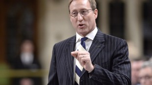 Justice Minister Peter Mackay rises during Question Period in the House of Commons on Parliament Hill in Ottawa, Thursday, April 30, 2015 . MPs will begin to grapple later Thursday with an issue that's sure to become a hallmark of the next Parliament: what does one do if a piece of legislation flies in the face of their fundamental beliefs? THE CANADIAN PRESS/Adrian Wyld