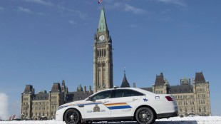 An RCMP police car sits outside the Parliament buildings on Parliament Hill in Ottawa on February 6, 2015. Will putting the Mounties in charge of security for all of Parliament Hill actually make it safer? The head of the union that represents the existing internal security team thinks not. THE CANADIAN PRESS/Adrian Wyld