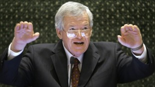 FILE - In this March 5, 2008, file photo, former U.S. House Speaker Dennis Hastert speaks to lawmakers on the Illinois House of Representatives floor at the state Capitol in Springfield, Ill. Federal prosecutors have indicted Thursday, May 28, 2015, the former U.S. House Speaker on bank-related charges. (AP Photo/Seth Perlman, File)
