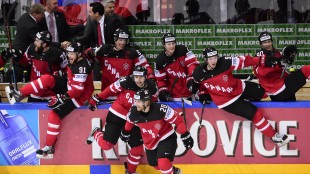 Team Canada celebrates after winning the gold medal match against Russia at the 2015 IIHF Ice Hockey World Championships on May 17, 2015 at the O2 Arena in Prague. AFP/Getty Images/ Jonathan Nackstrand