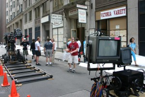 A film crew sets up a shot for the Cinderella Man in downtown Toronto on Thursday Aug. 5, 2004. The film shows the story of Depression-era fighter and folk hero Jim Braddock, who defeated heavyweight champ Max Baer in a 15-round slugfest in 1935. The film stars Russell Crowe and Renée Zellweger, directed by Ron Howard. (CP PHOTO - Steve White)